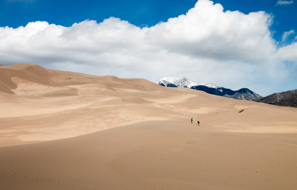 Walking up the red sand dunes in Great Sand Dunes National Park